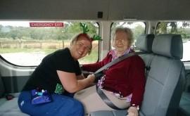 Annette is securing Sylvi Manttari's safety belt